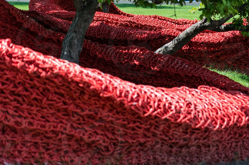 pattern repetition repeat design texture red green sculpture trees flow sinuous curve photo