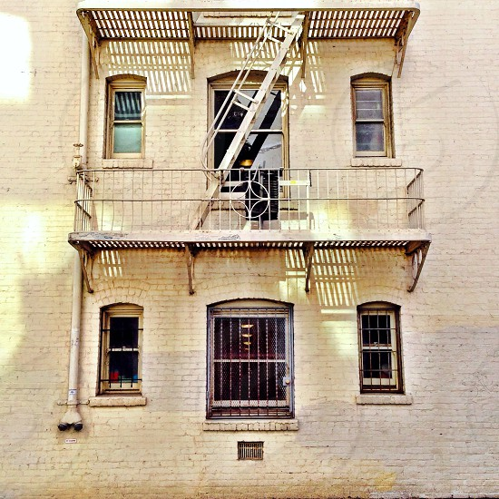 view of white painted balcony of a building photo