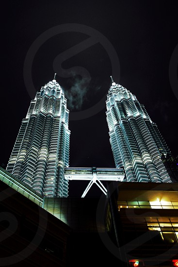 low angle photography of petronas twin tower during night time photo