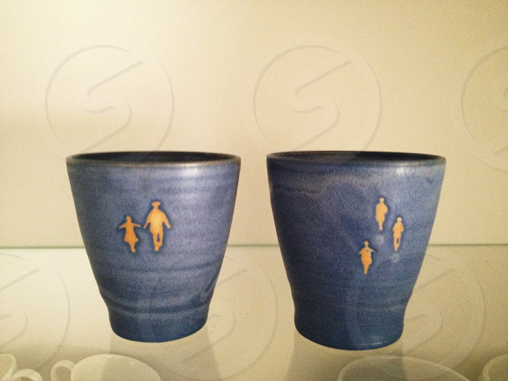 blue and yellow ceramic pots photo