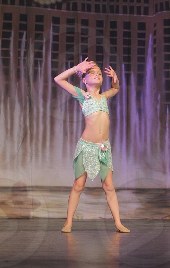 Girl kid dance dancing ballet stage child pose portrait costume competition lyrical smile smiling children performance  photo