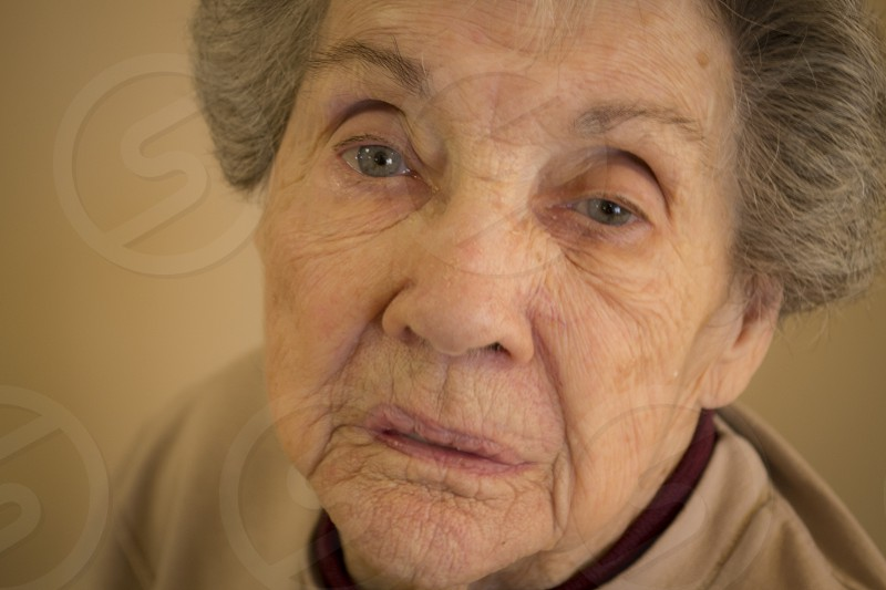 Innocent victim of cyber crimes have many faces. Grandma's sad expression. photo