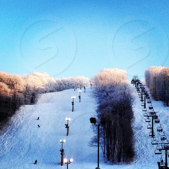 ski lift on snowy ground view photo