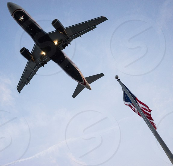 lower angle view of white airplane in the sky photo