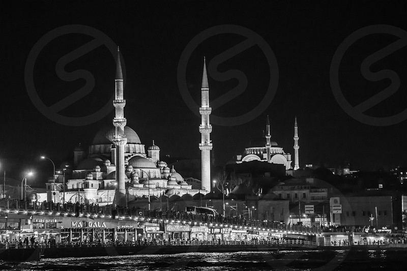 East Meets West - Istanbul Turkey were old eastern cultures merge & blend with western cultures. The image is of the Galata Bridge in the shadows of the Mosques. photo