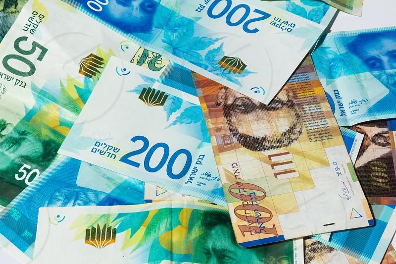 Stack of various of israeli shekel money bills - Top View. photo