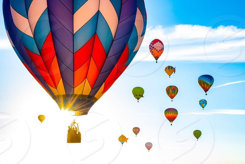 hot air balloon sunrise sun sky blue aviation flight adventure fly float colors colorful pilot photo