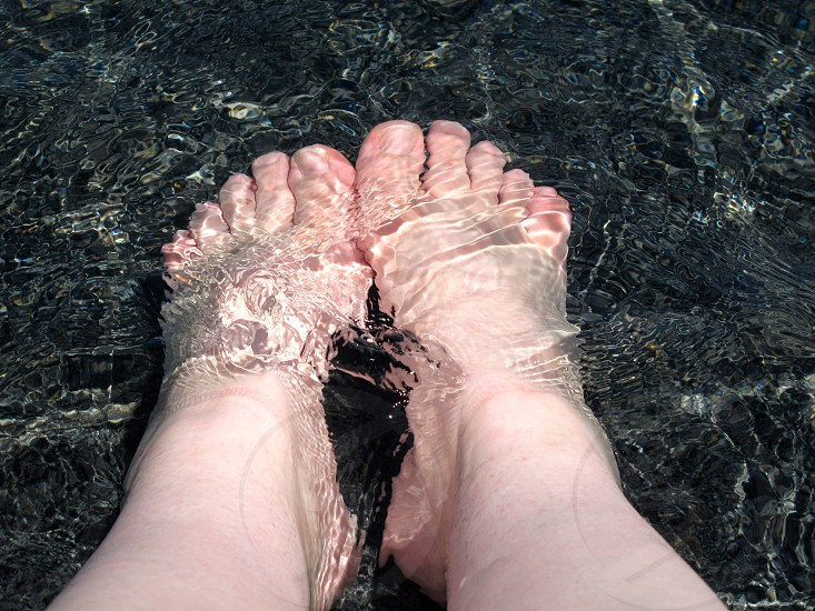 cooling off in the fountain feet toes water photo