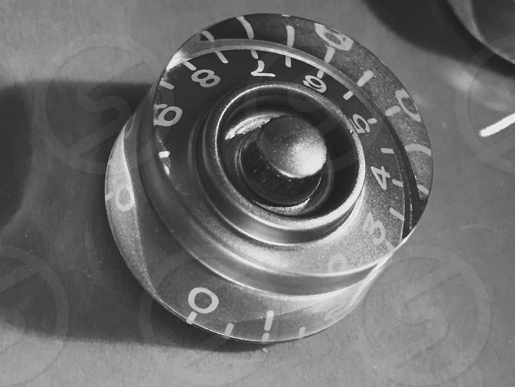 closeup grayscale photo of round analog knob photo