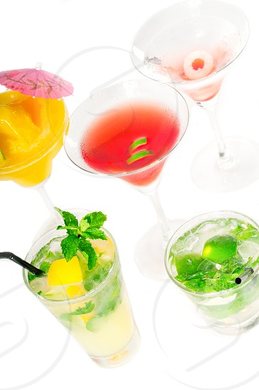 group of classic colorful cocktails drink isolated on white background photo