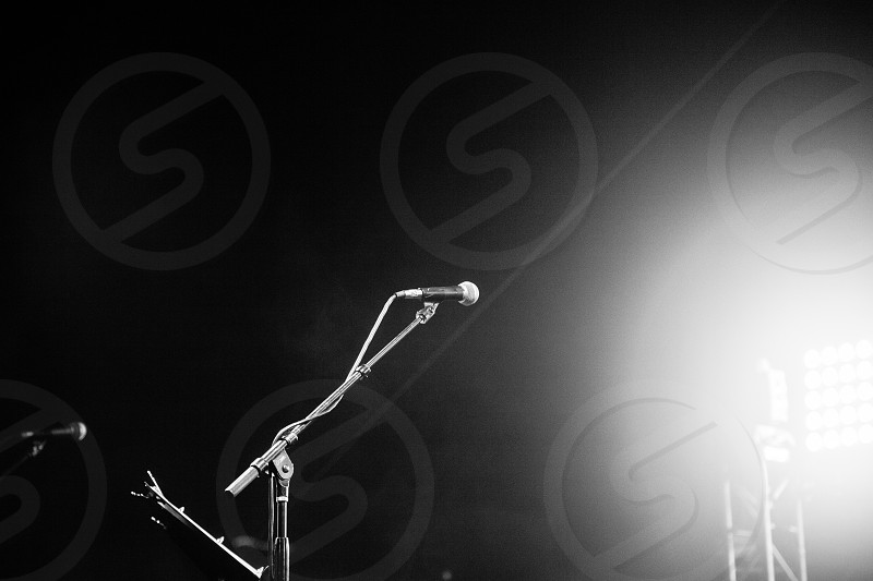 silver and black microphone during night  in grayscale photography photo