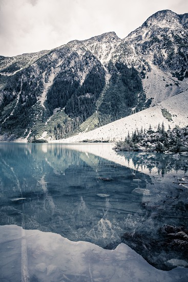 Mountain Landscape view with reflections on Upper Joffre Lake at the backcountry Campgound in British Columbia Canada photo
