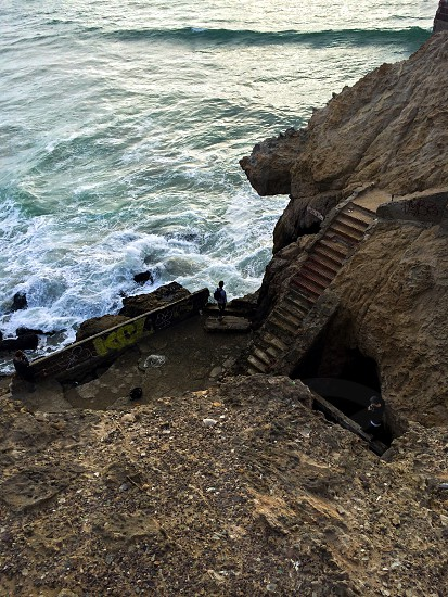 staircase on the rock hill near the sea photo