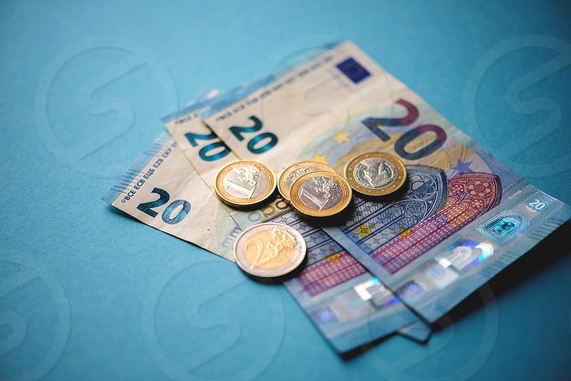 Cash money closeup on blue background photo