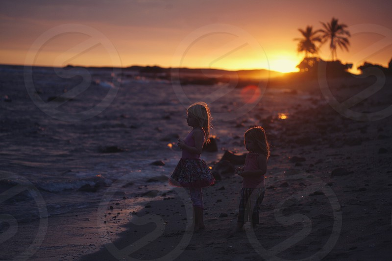 sunset Hawaii ocean waves two little girls reflective peaceful peace breathe  photo