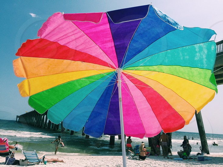 Colorful Umbrella at the beach. photo