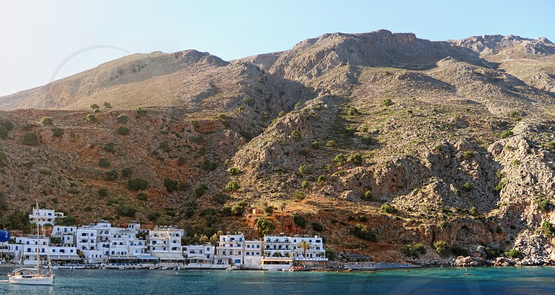 Village Loutro on south coast of Crete Greece. white houses on mountain side and small port. photo