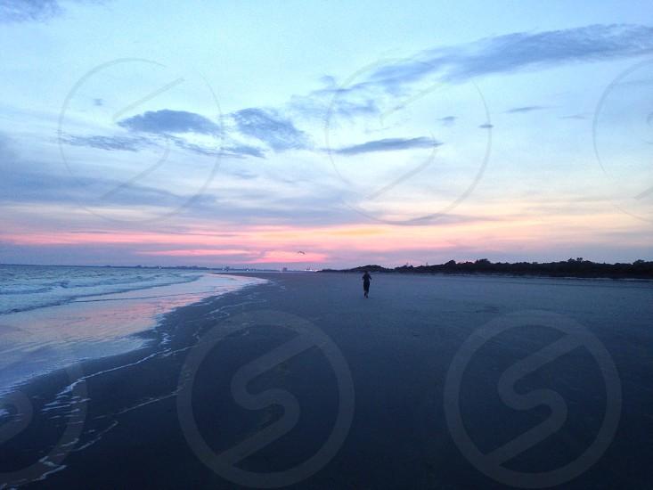 man walking in seashore photo