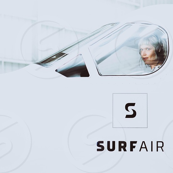 surfair ad with a woman in a white airplane cockpit photo
