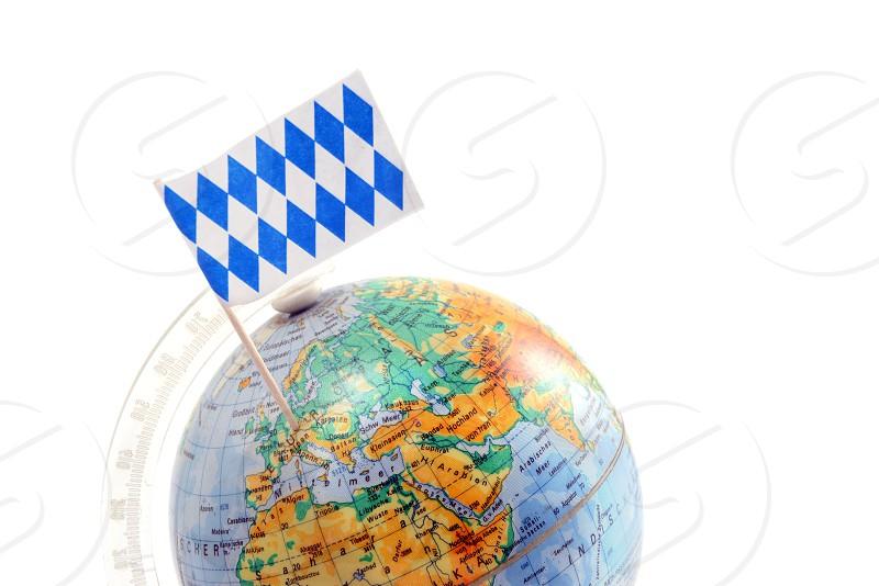 globe with bavarian flag stucking on bavaria. copy space. white isolated background photo
