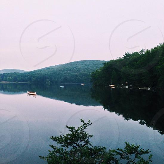 white boat on the lake photo