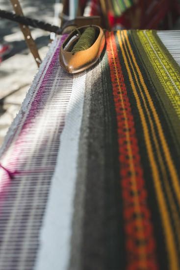 Vintage loom and yarn. Knitting carpet photo