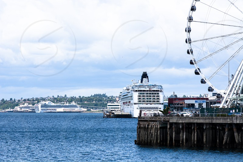 Seattle the port of call for cruise ships sailing to Alaska as well as multiple tourist attractions like the Great Wheel on the pier overlooking Puget Sound. photo