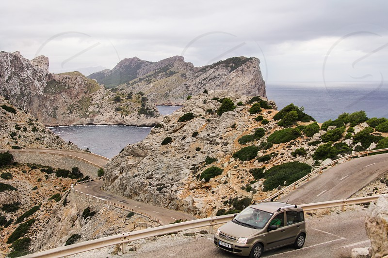 Landscape coastline winding road rocky Mediterranean photo