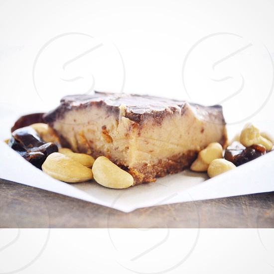 slice of cake with cashew nuts photo