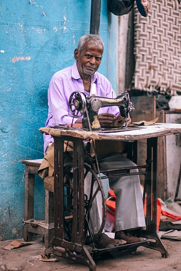 Traditional Indian tailor. photo