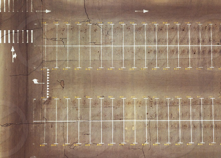 Panoramic view from the drone on a lot of empty parking spaces. Top view photo