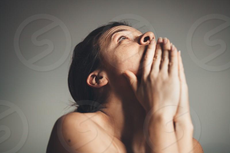 Young woman sad and praying photo