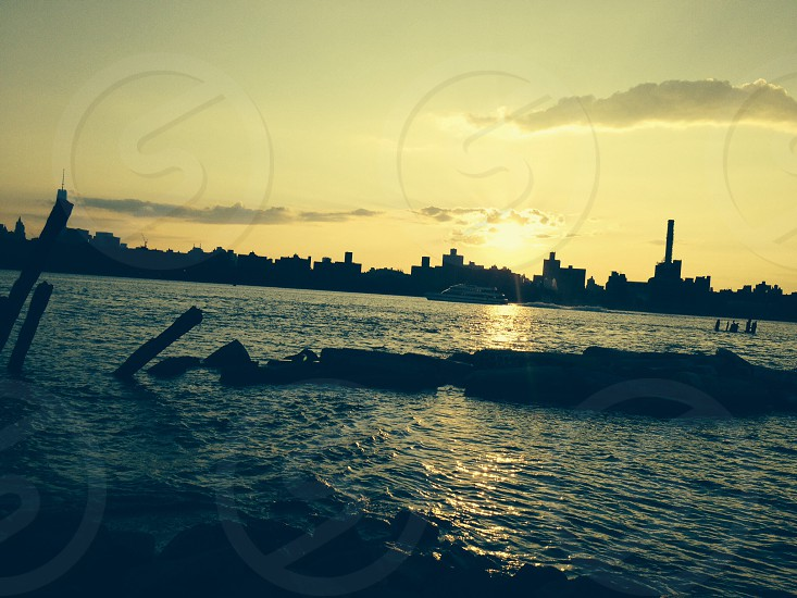 Manhattan across the water and under the sun photo
