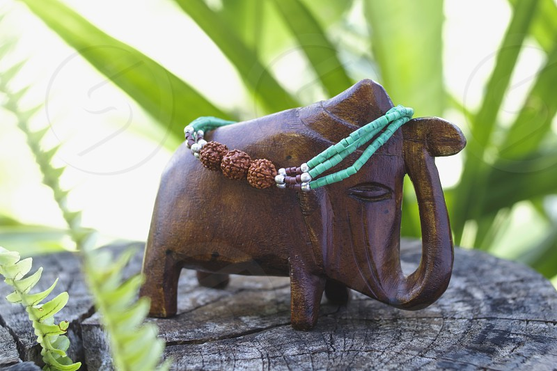 bracelet on the wooden elephant photo