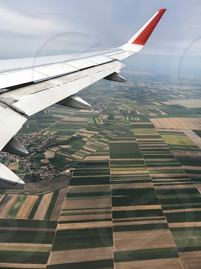 Aerial view from aircraft on a rectangular fields photo