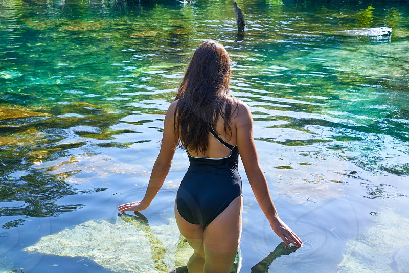 Beautiful teen girl in cenote of Riviera Maya with swimsuit photo