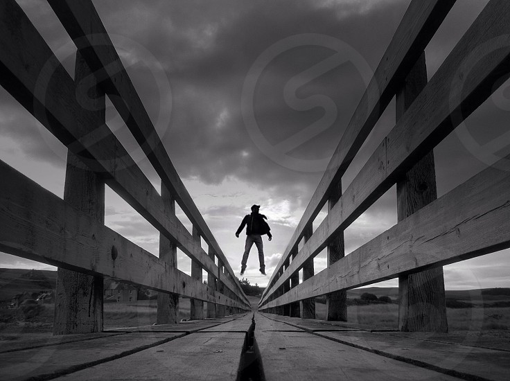 man jumping on road photo