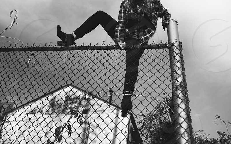 edgy escape breaking in rebel plaid shoes candid street photography model anonymous black and white urban street city model  photo