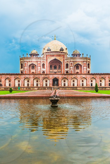 Humayun's Tomb a UNESCO World Heritage Site with a reflection in water after monsoon.  photo