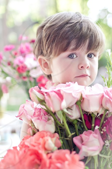 child kid girl flowers emotion positive gently romantic photo