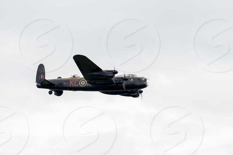 Avro Lancaster bomber flying over Shoreham Airfield photo
