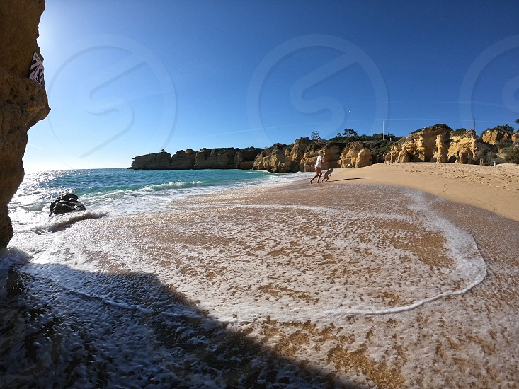 Nature beach rocks portugal summer ocean mom and children playing  photo