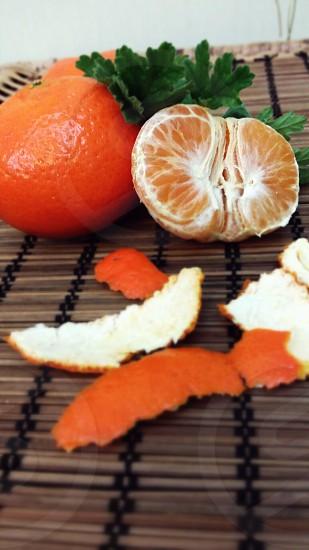 peeled orange fruit on brown wooden surface photo