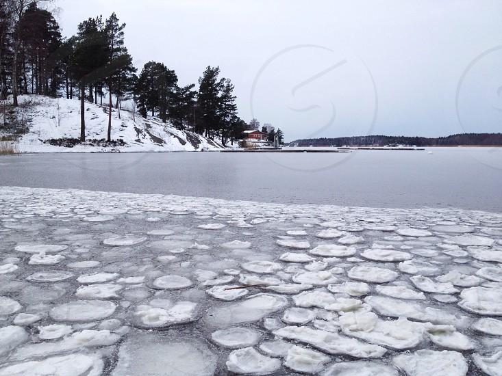 white ice sheets on lake surface photo