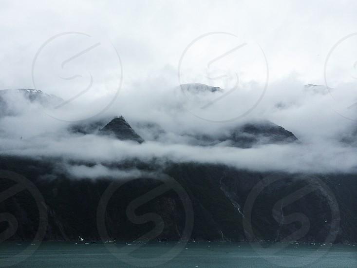 cloudy mountain peak photo
