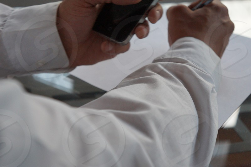 man in white formal shirt using black ipad photo