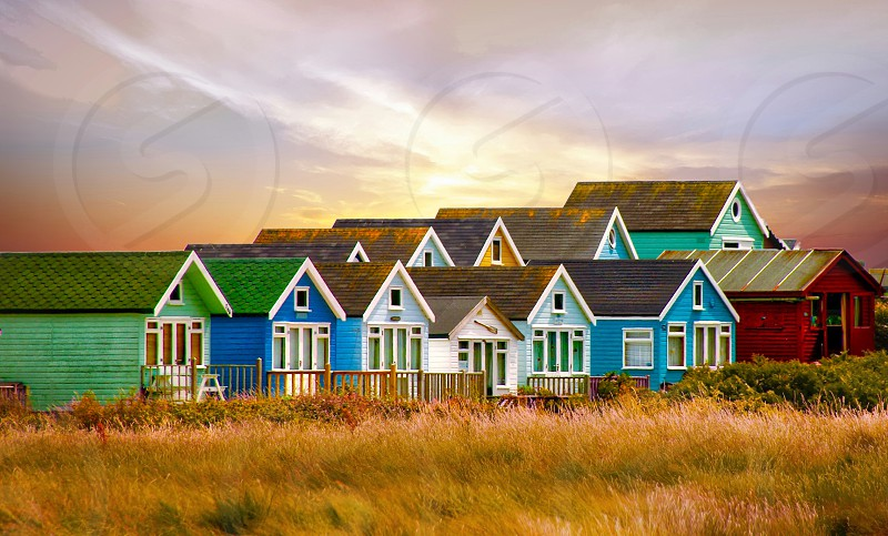 Morning light over seaside cabins photo