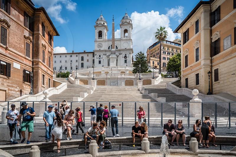 Piazza di Spagna and spanish steps to Piazza della Trinita dei Monti with no people a sunny summer day photo