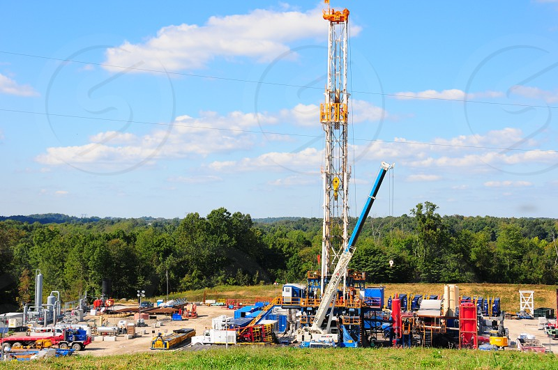 Land based drill rig in Eastern Ohio. This oil and gas rig is drilling to approximately 5000 feet vertical and about the same amount horizontal to tap into the Utica Shale Formation. The drill pad is about 300 by 400 feet. photo