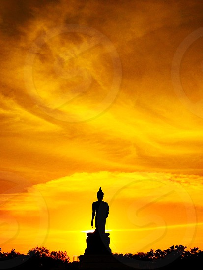 Buddhamonthon Buddhism park outdoor sunset red orange gold silhouette shadow reflection sundown calm serenity peace silence relax pray quietness zen meditation still practice religion Thailand Bangkok photo